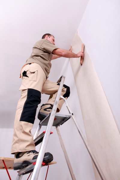 3484367-wall-papering-man